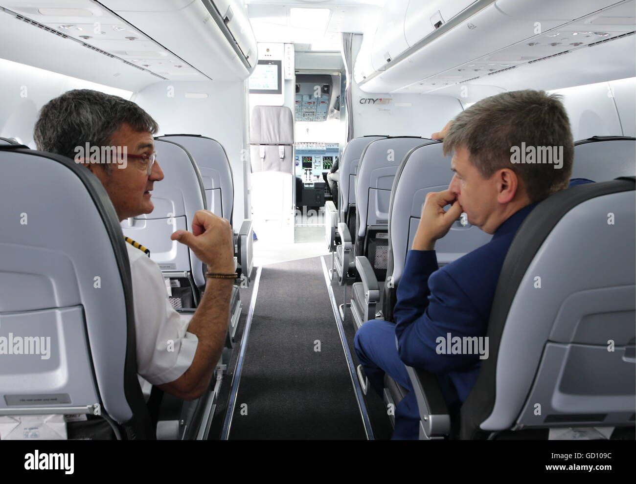 Farnborough, United Kingdom. 11th July, 2016. People in the cabin of a Sukhoi Superjet 100 of the Irish airline - Stock Image