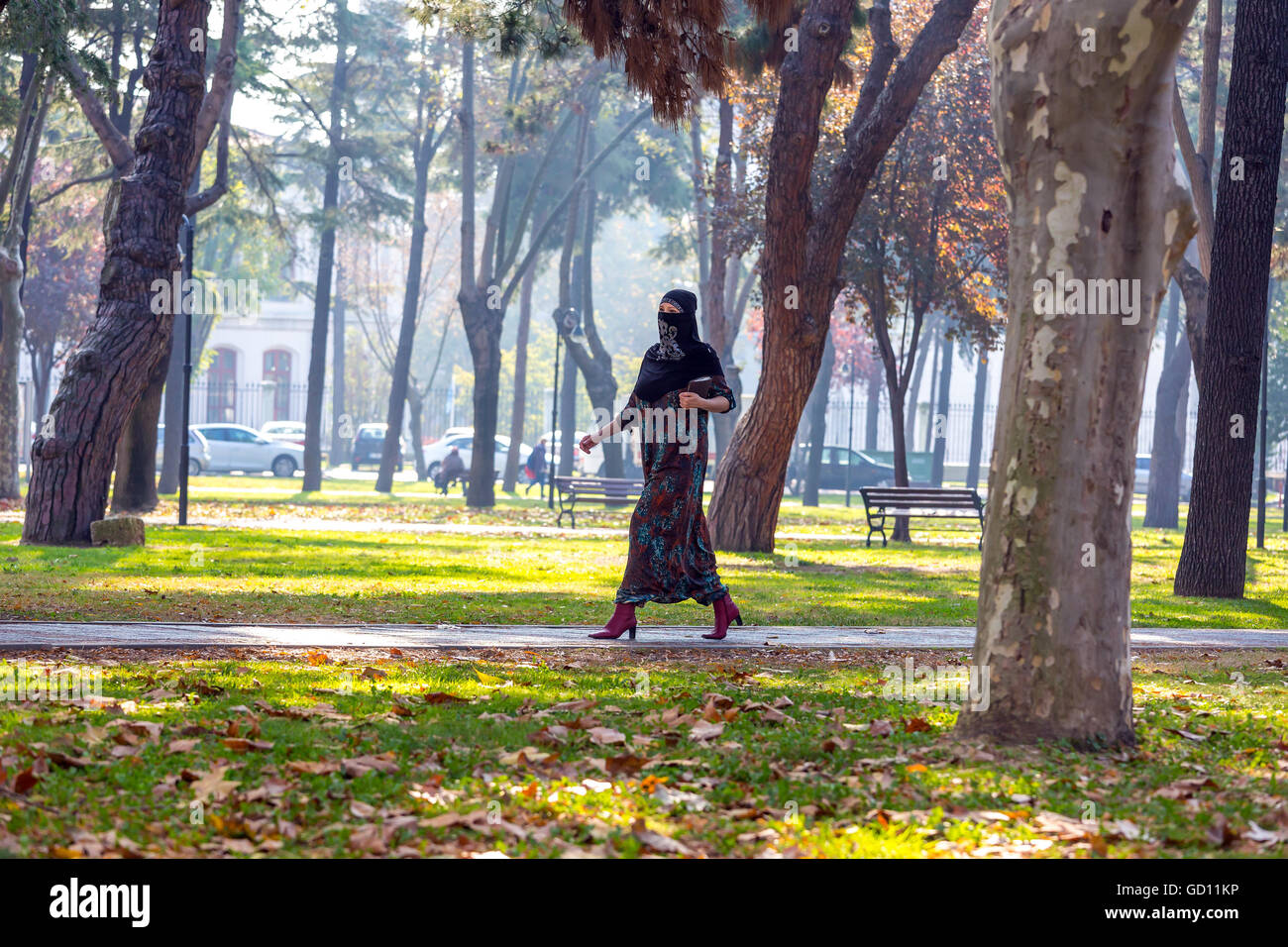 young muslim woman walking in park stock photo 111276026