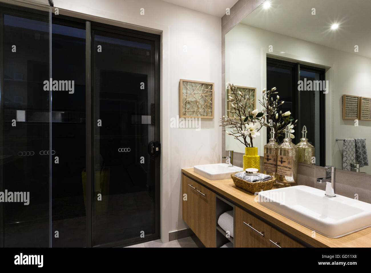Luxury washroom with lights on at night next to a black glass door luxury washroom with lights on at night next to a black glass door mozeypictures Choice Image