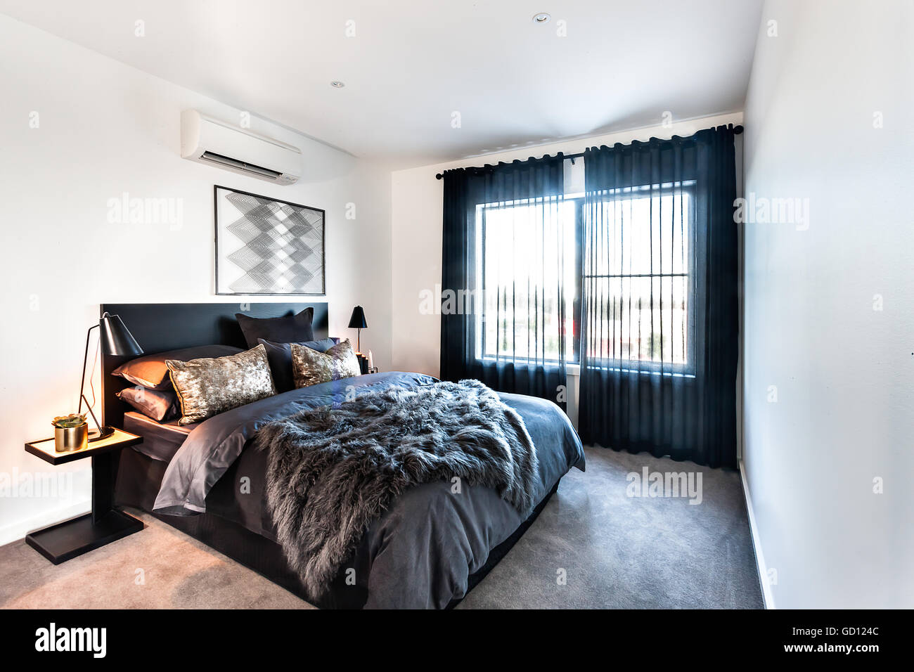 . Luxury bedroom with fur bed sheet on the master bed with pillows
