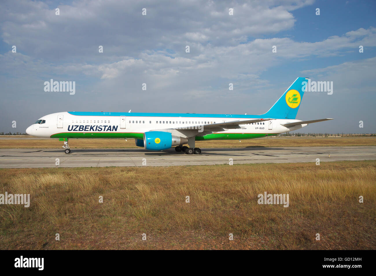 Simferopol, Ukraine - September 13, 2010: Uzbekistan Airways Bowing 757-200 is taxiing along the taxiway in the - Stock Image