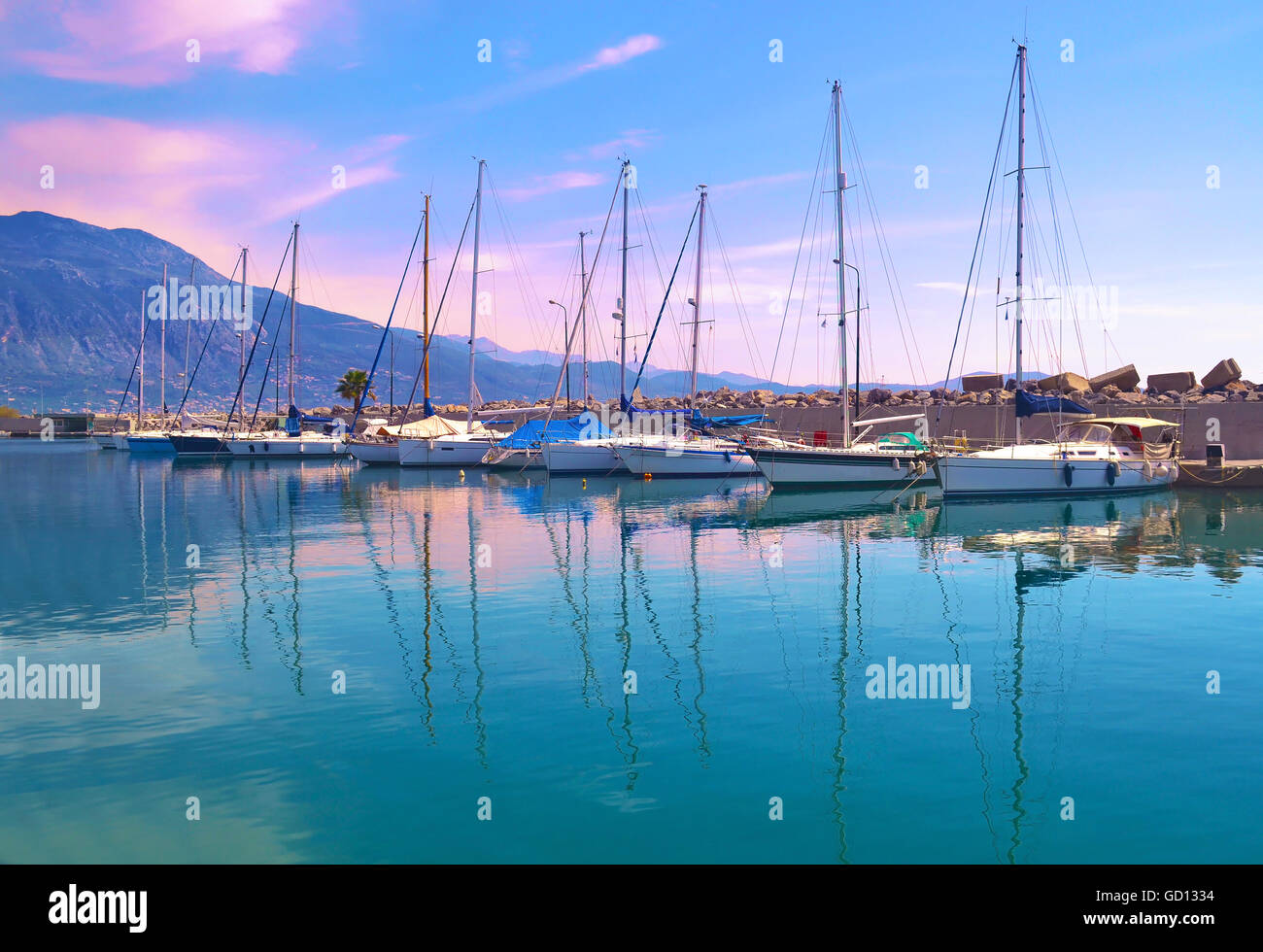 sunset boats reflection at Kalamata harbor Peloponnese Greece - Stock Image