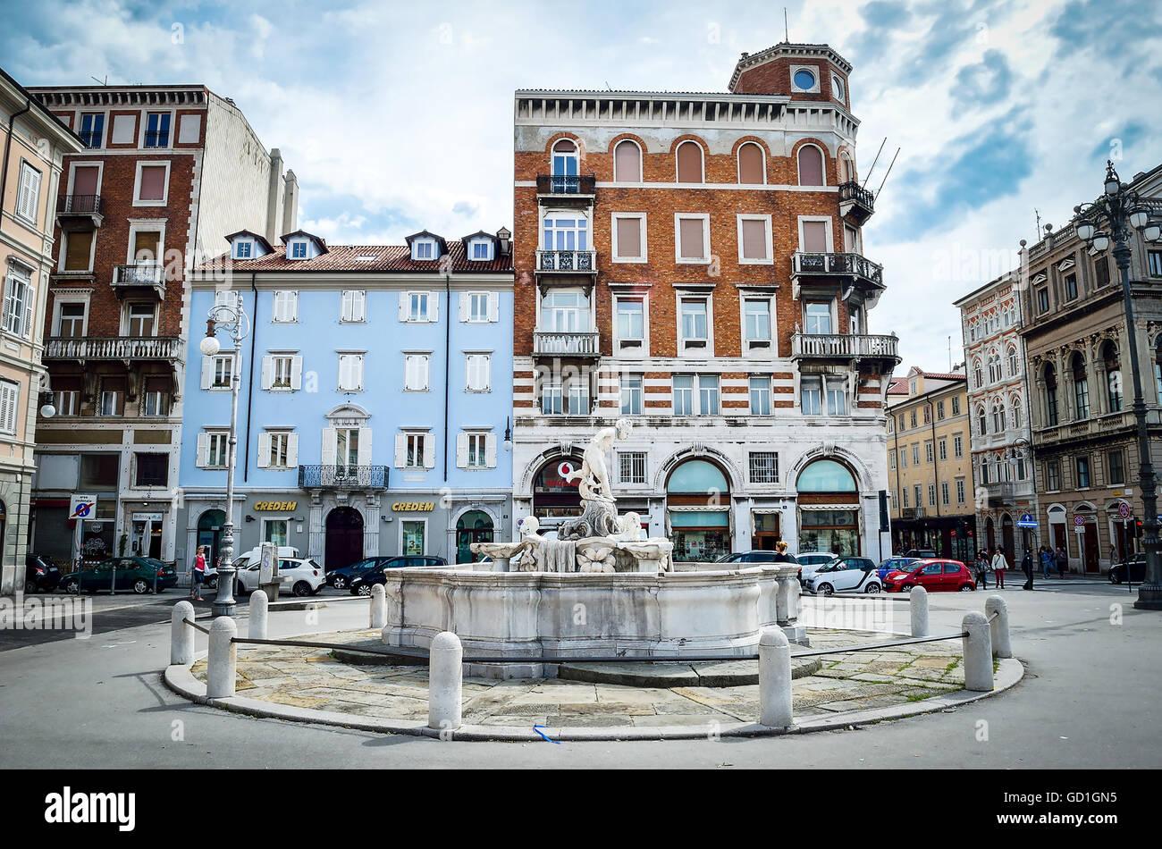 Trieste  Italy circle fountain Ponterosso square colofull buildings - Stock Image