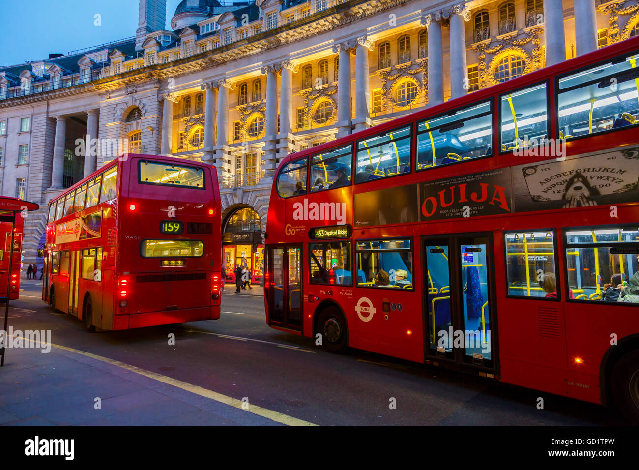 Traditional red buses. Picadilly street. London, England, United Kingdom, Europe. - Stock Image