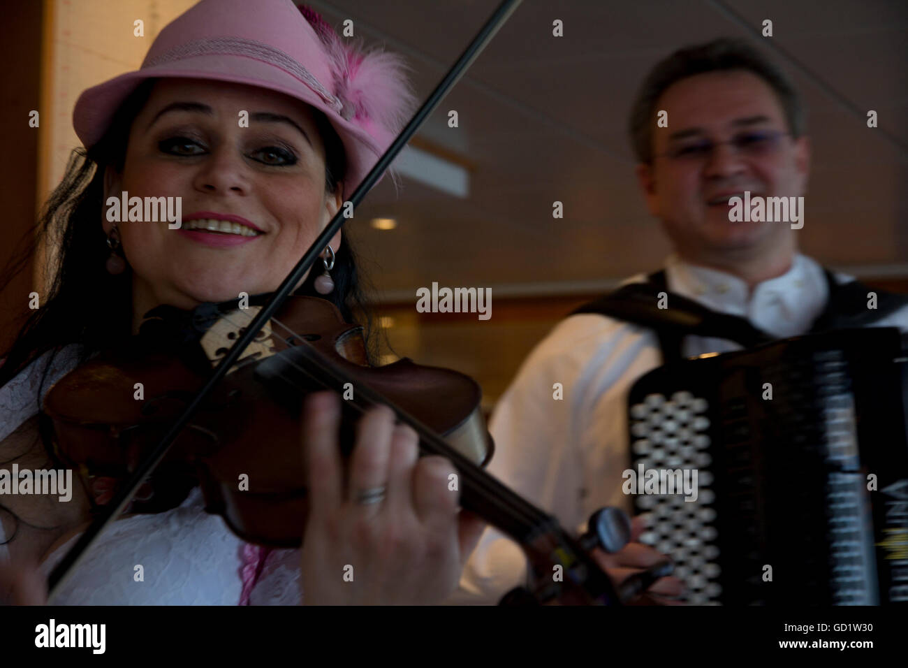 Local German entertainers perform during the 'Taste of Germany' buffet dinner onboard Viking Alruna during - Stock Image