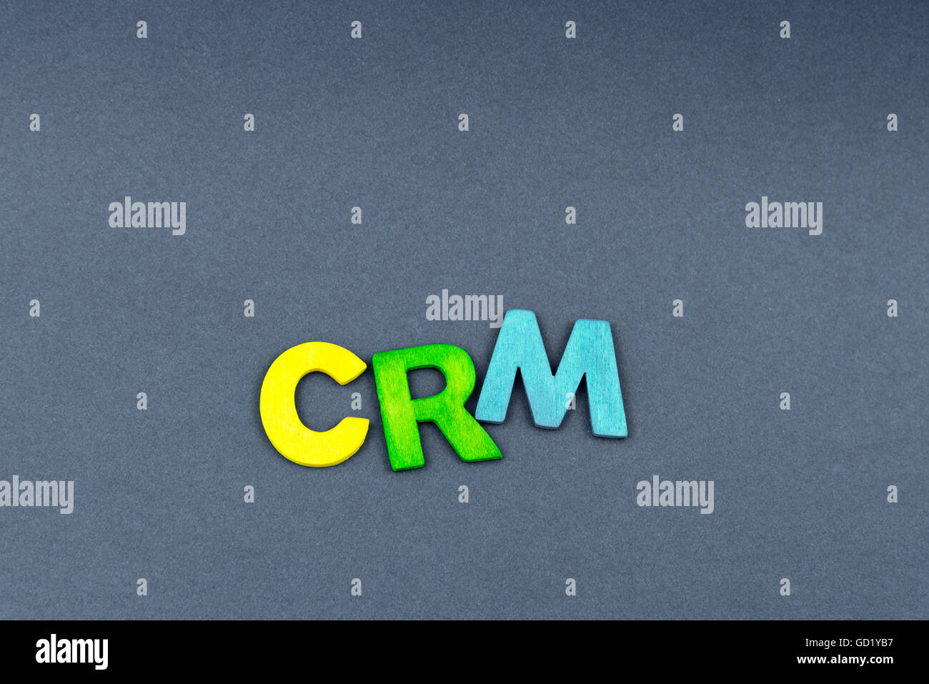 Business Abbreviation CRM as Customer Relationship Management created of wood letters on dark background, copy space - Stock Image