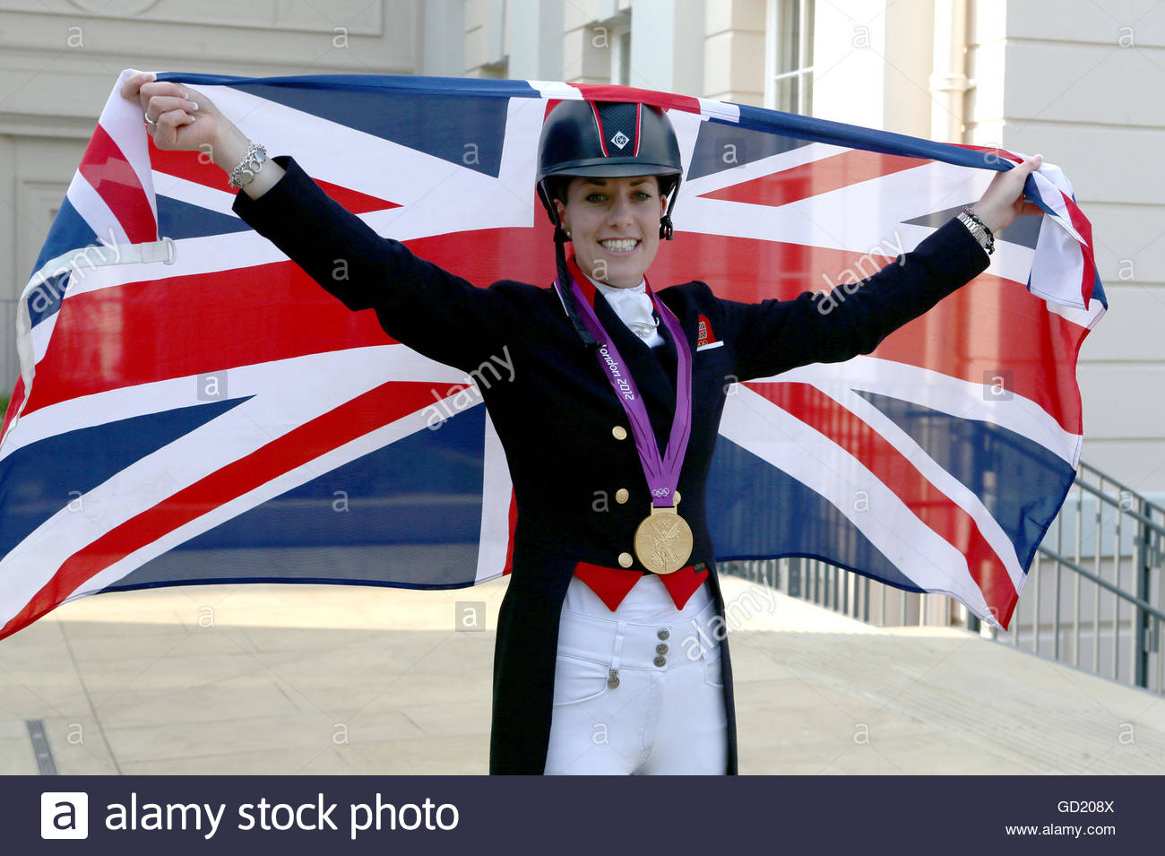 File photo dated 09-08-2012 of Great Britain's Charlotte Dujardin celebrates after winning gold in the Equestrian Stock Photo