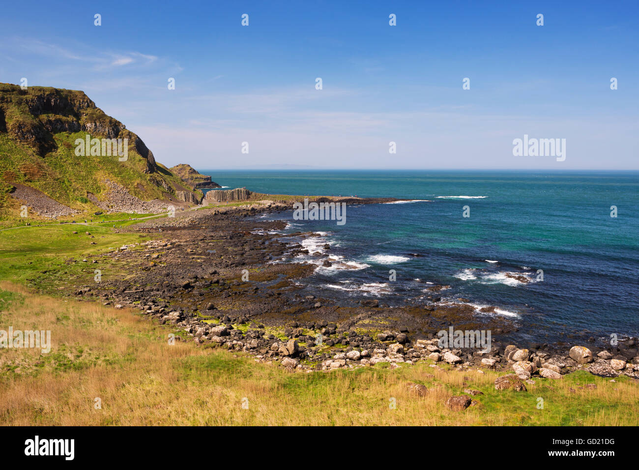 The rocky coast at the Giant's Causeway in Northern Ireland on a bright and sunny day. - Stock Image