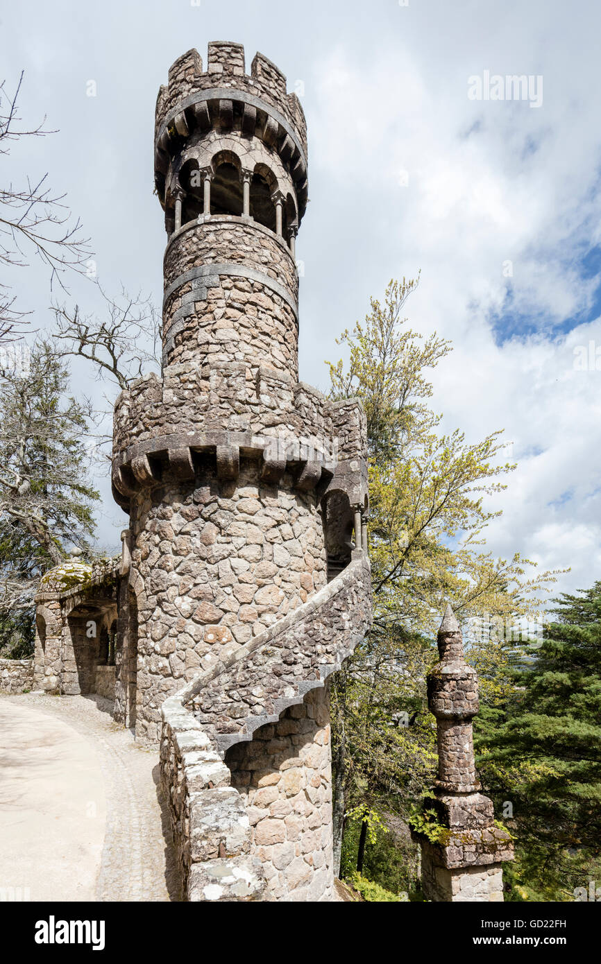 Old mystical tower of Romanesque Gothic and Renaissance style inside the park Quinta da Regaleira, Sintra, Portugal, - Stock Image