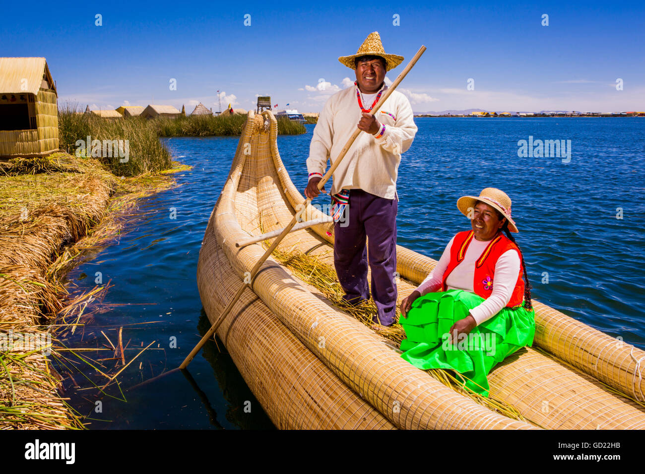 Quechua Indian couple on Floating Grass islands of Uros, Lake Titicaca, Peru, South America - Stock Image