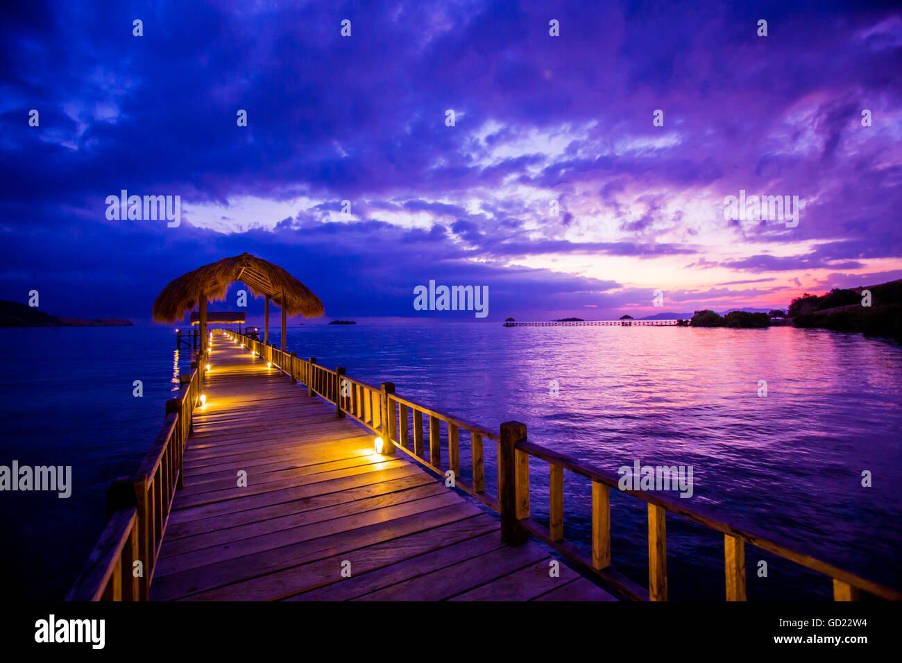Sunset over the Pier, Hotel Seraya, Flores Island, Indonesia, Southeast Asia, Asia - Stock Image