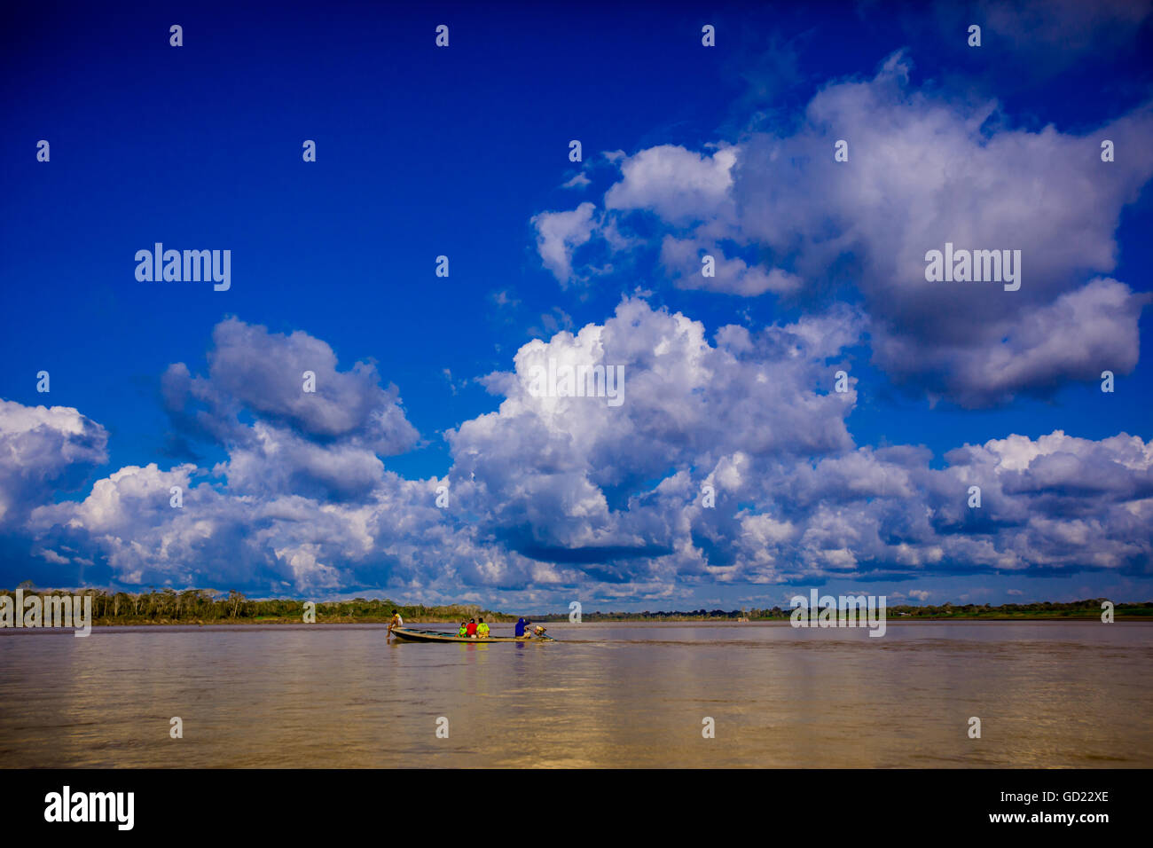Family on a canoe, Amazon River, Iquitos, Peru, South America - Stock Image