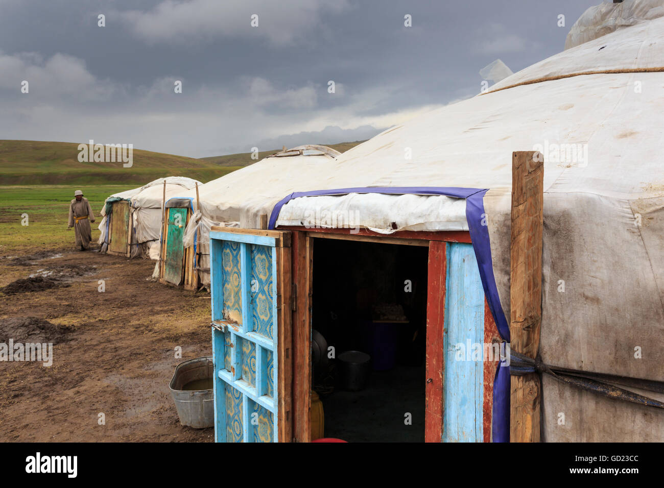 Gers at a Summer nomad camp under dark skies with nomadic man wearing deel, Khujirt, Uvurkhangai (Ovorkhangai), - Stock Image