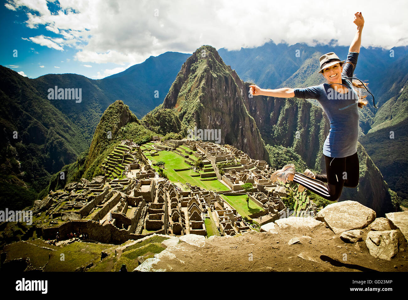 Laura Grier jumping at Machu Picchu ruins, Peru, South America - Stock Image