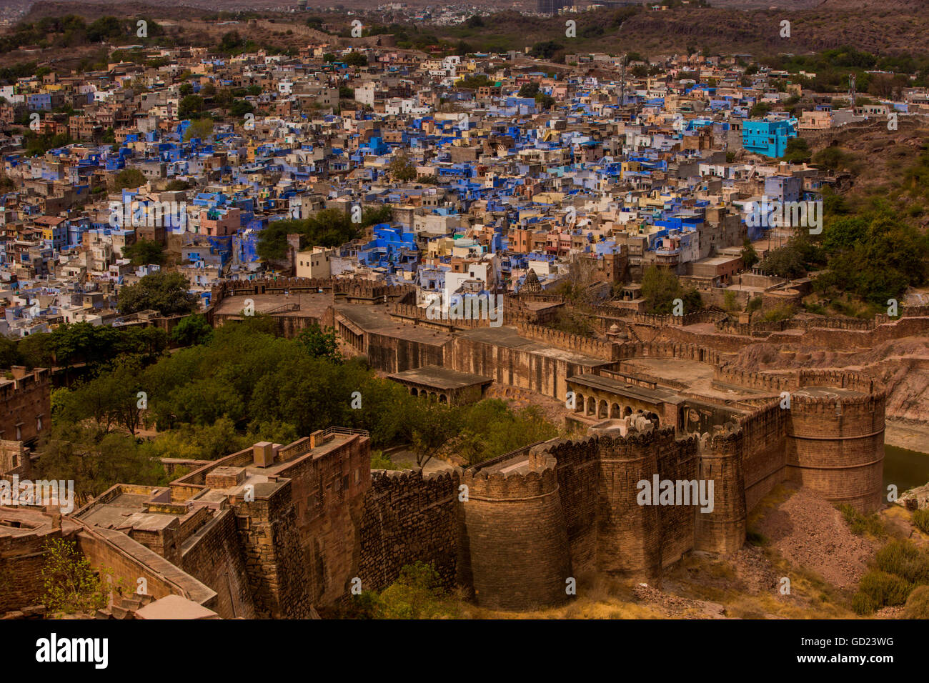 The palace walls of Mehrangarh Fort towering over the blue rooftops in Jodhpur, the Blue City, Rajasthan, India, - Stock Image