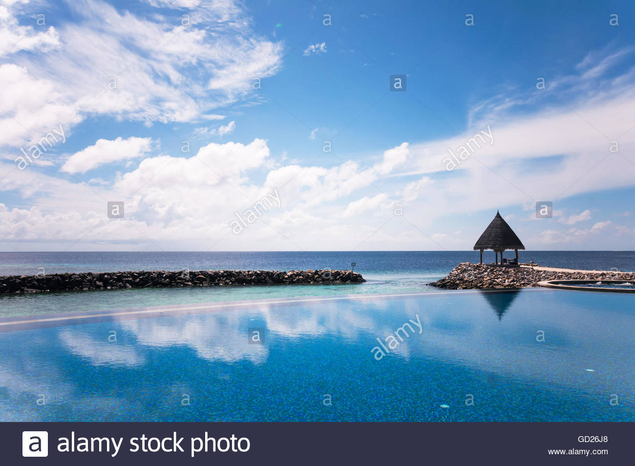 Infinite swimming pool of Maldivian resort at the blue ocean lagoon ...