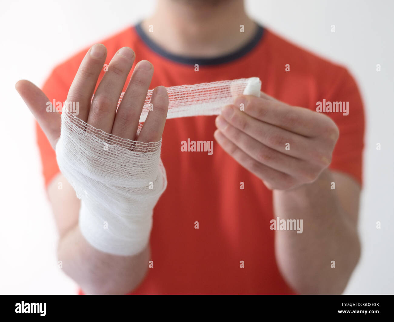 sport man with bandages medication on his hand suffering after a sport injury - Stock Image