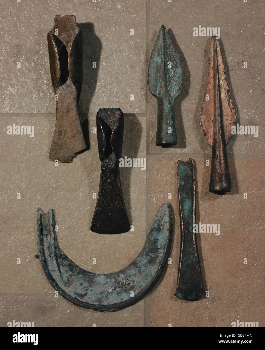 weapons, axe blades and spearheads, besides a sickle, copper, Schaefstall, Swabia, urnfield culture, 1200 - 800 - Stock Image