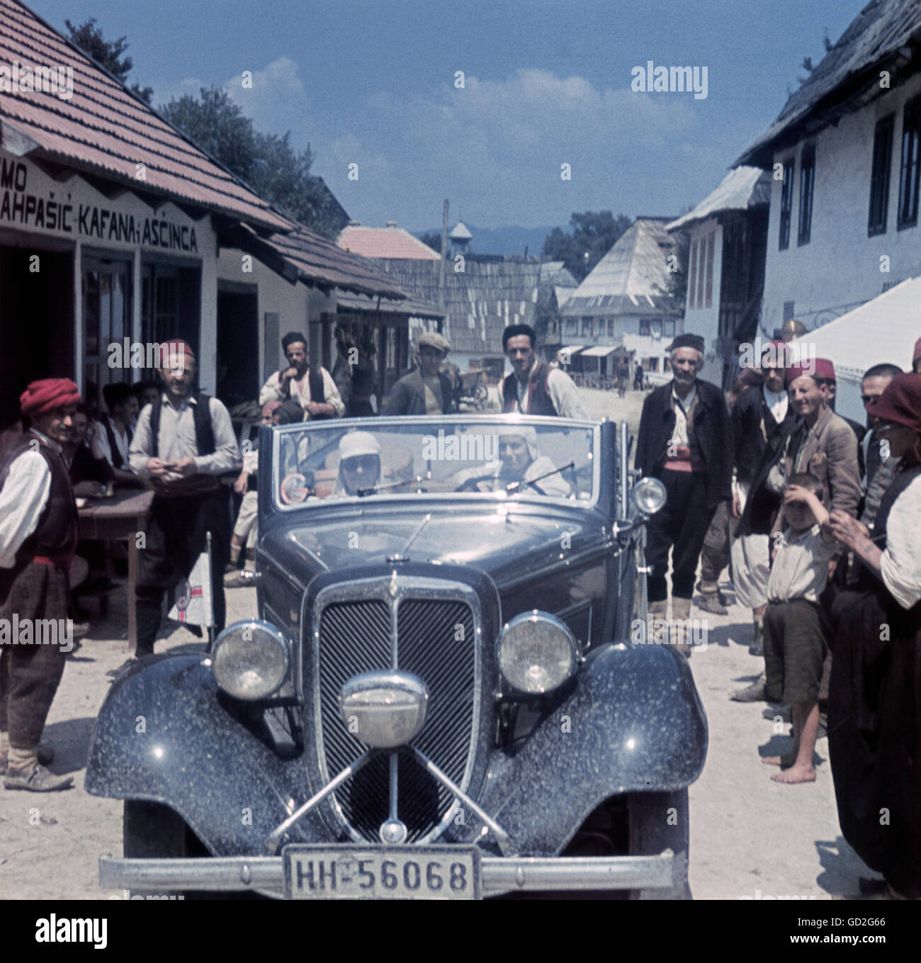 transport / transportation, car, 1930s, couple in convertible car in Bosnian village, Bosnia and Herzegovina, 1939, - Stock Image