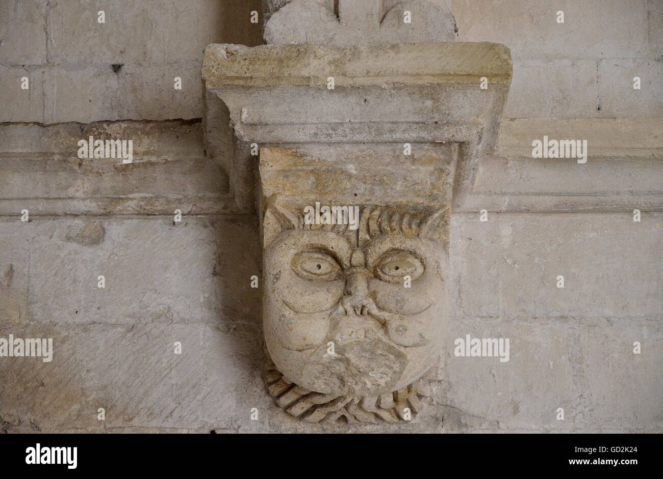 fine arts, romanesque period, carving of a tarasque, the legendary monster of Provence, devouring a man, Cloister - Stock Image