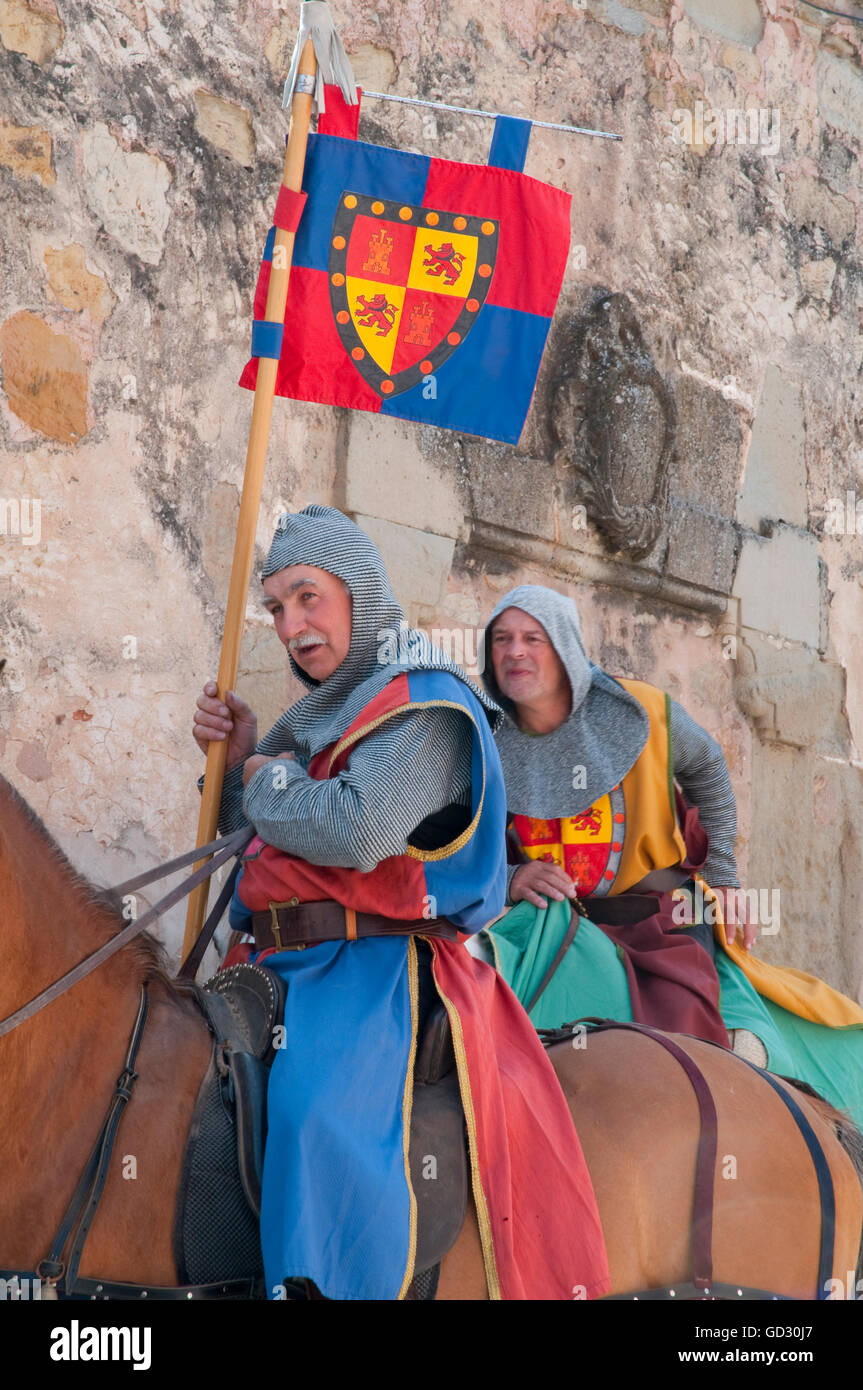 Two men wearing medieval clothes and riding horses. Medieval Days, Sigüenza, Guadalajara province, Castilla - Stock Image