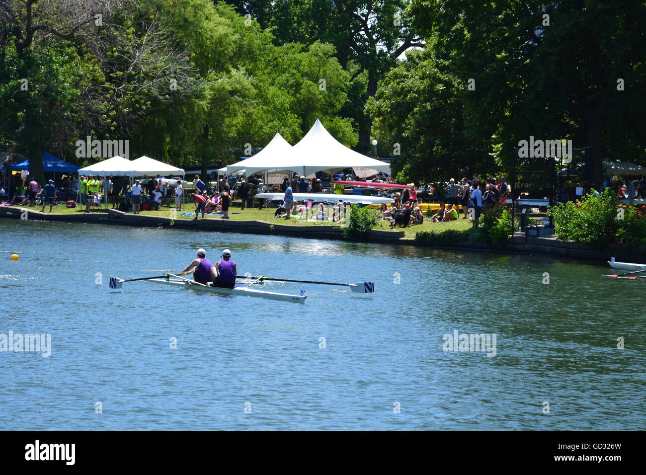 Boats race down the Lincoln Park Lagoon Henley style at the 36th annual running of the Chicago Sprints Regatta, - Stock Image