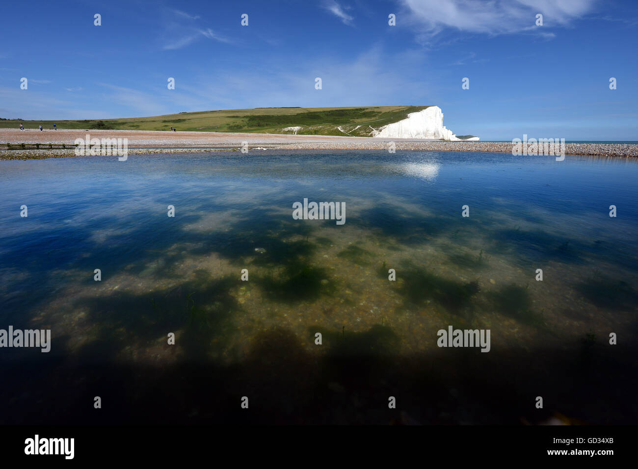 The iconic view of the English coast, Seven Sisters chalk cliffs, East Sussex - Stock Image