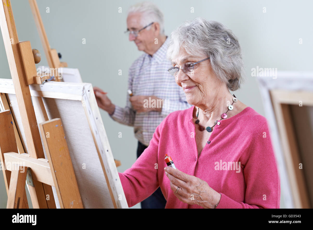 Seniors Attending Painting Class Together - Stock Image