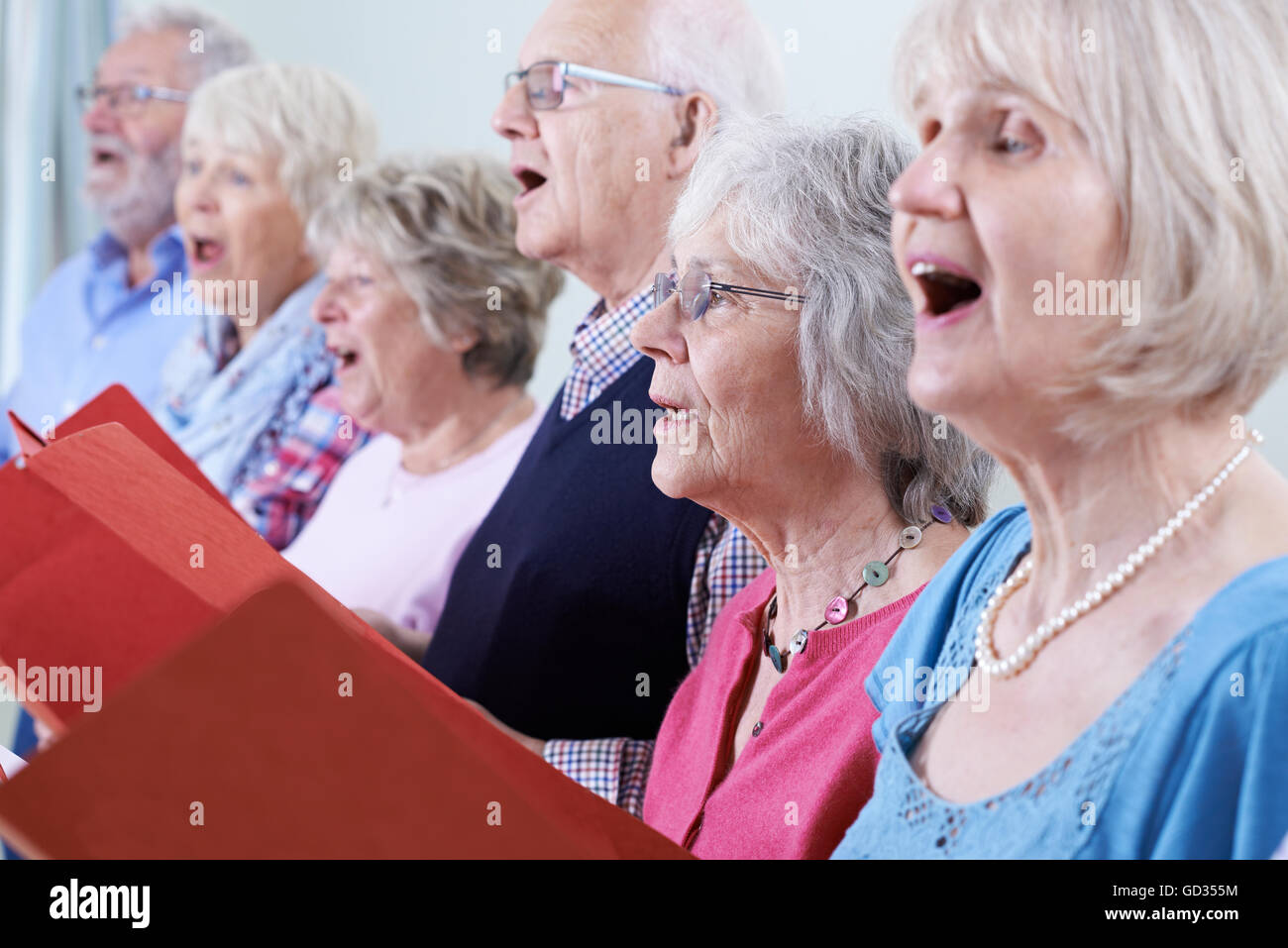Group Of Seniors Singing In Choir Together - Stock Image