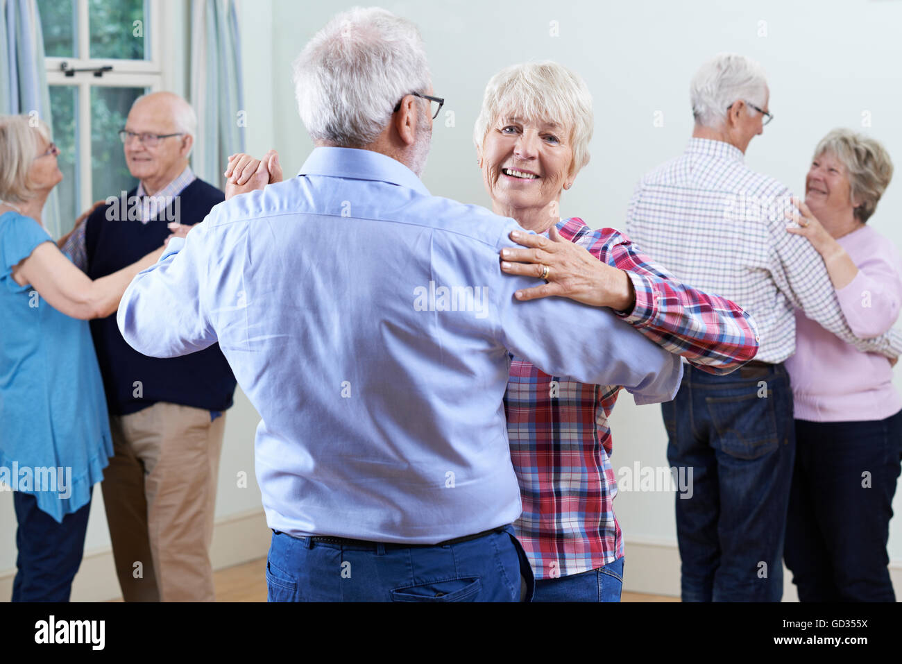 Group Of Seniors Enjoying Dancing Club Together - Stock Image