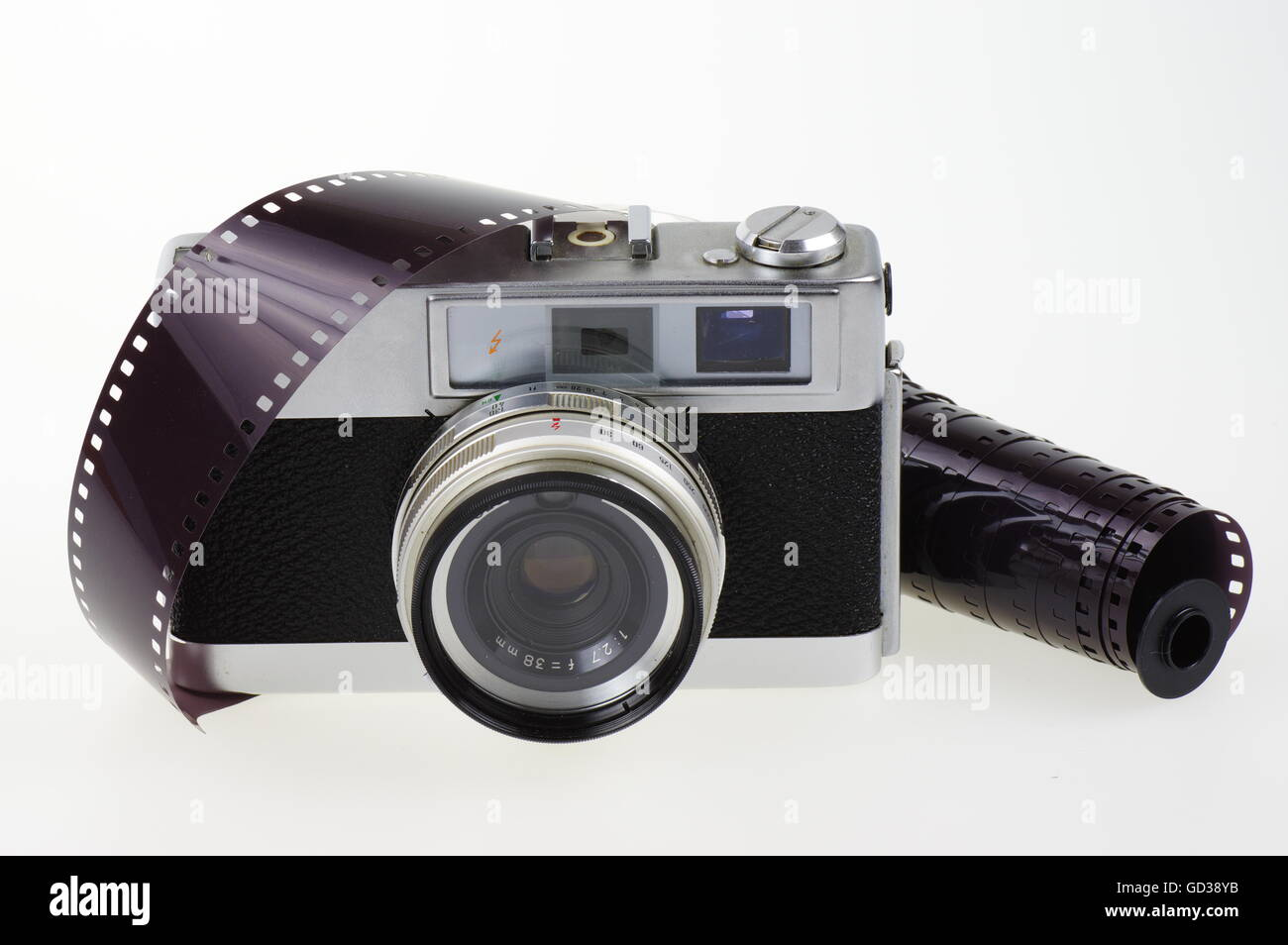 Old rangefinder analog camera system 135 and the photographic film on the white background. Stock Photo