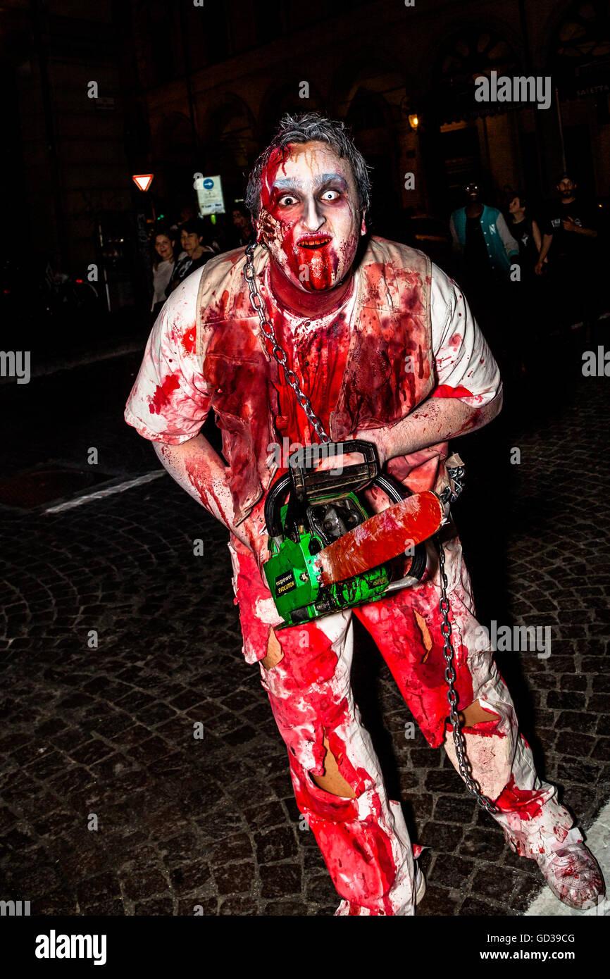 Crazy maniac with chainsaw - Stock Image