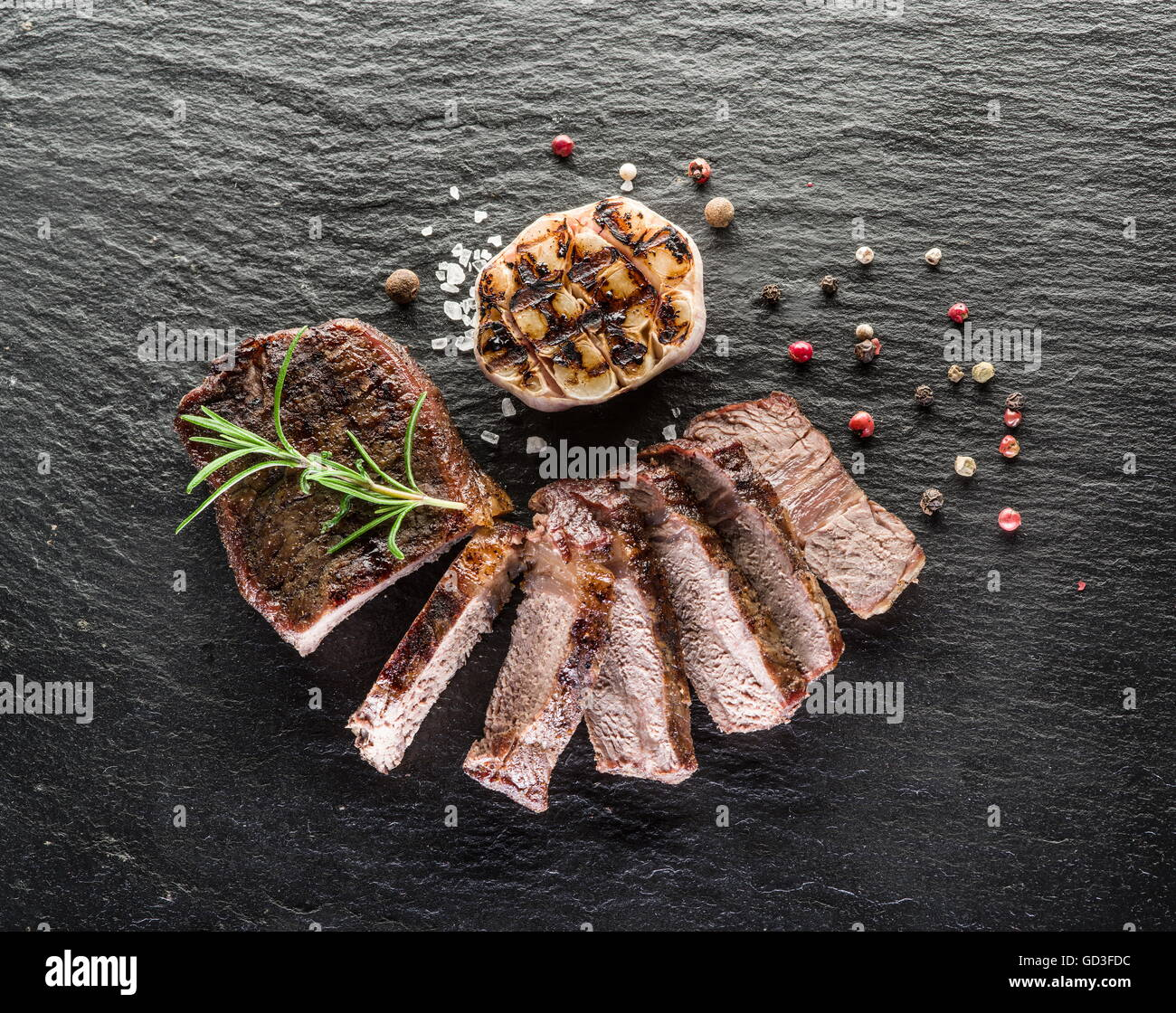 Steak Rib eye with spices on the graphite board. - Stock Image