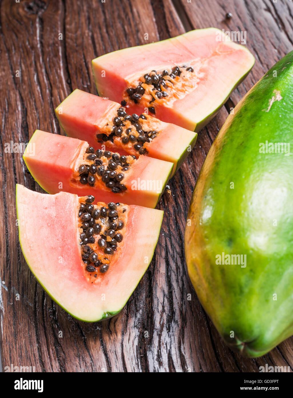 Papaya fruit on wooden background. - Stock Image