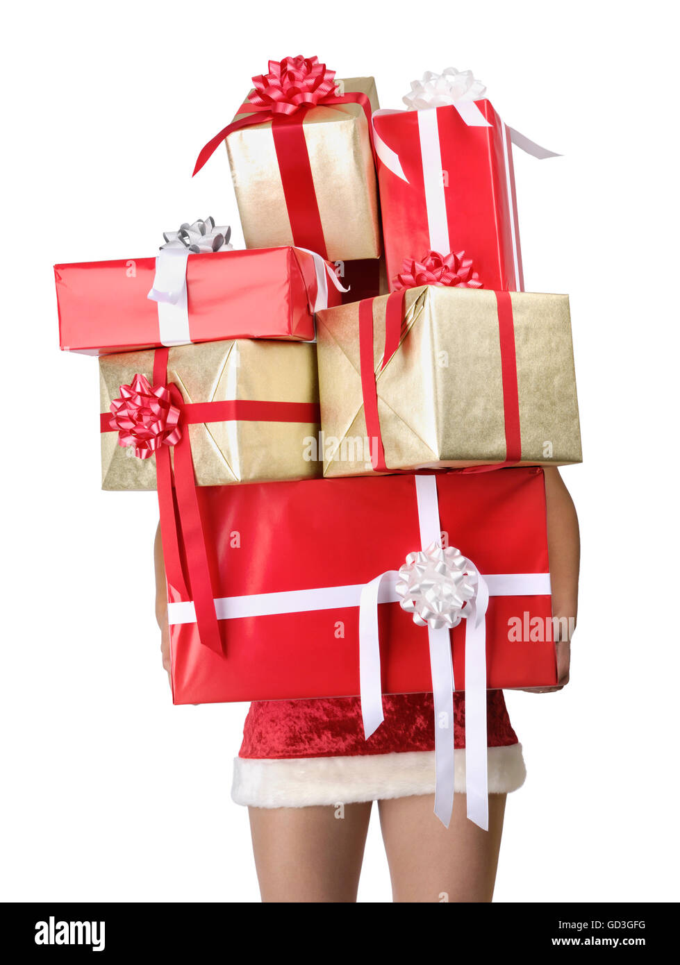 Woman with lots of Christmas gifts with only legs visible - Stock Image