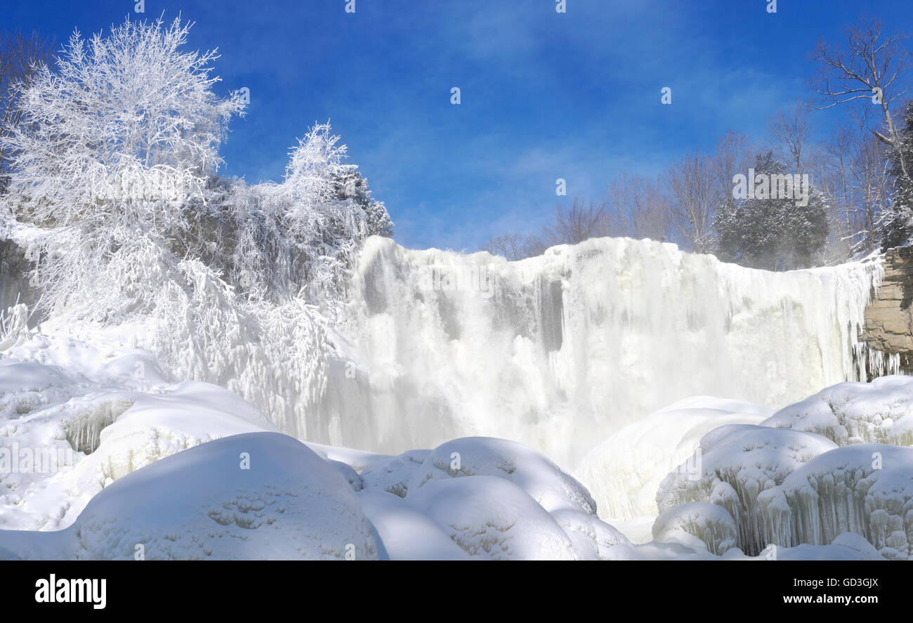 Wintertime scenery of frozen nature around Webster's Falls waterfall in Dundas, Hamilton, Ontario, Canada - Stock Image
