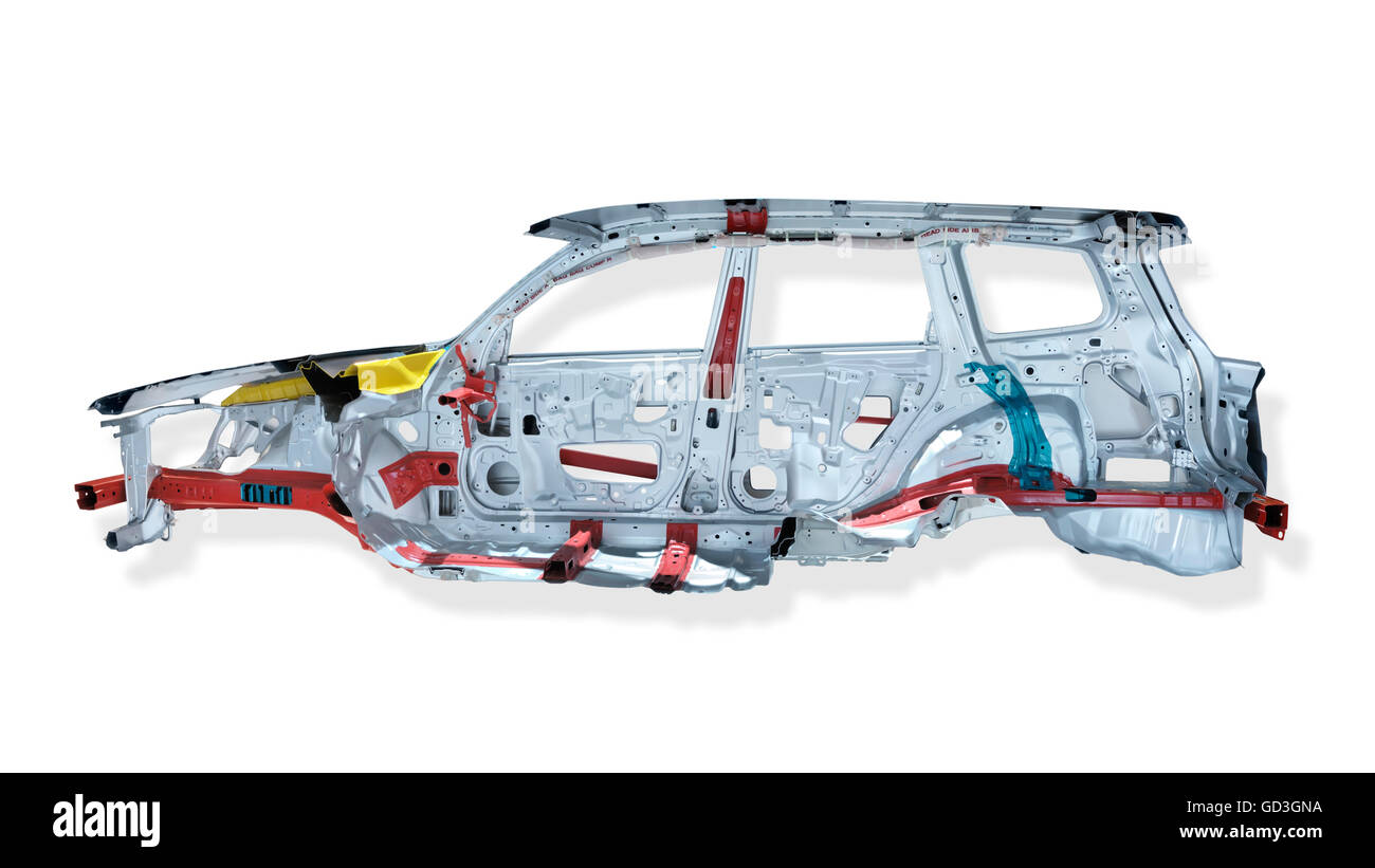 Cross section of automobile showing safety features, reinforced frame and air bags - Stock Image