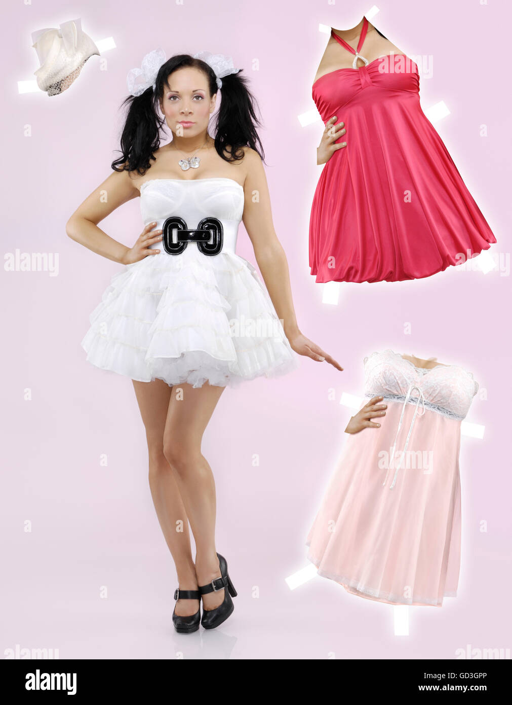 Paper doll woman and fancy clothes - Stock Image