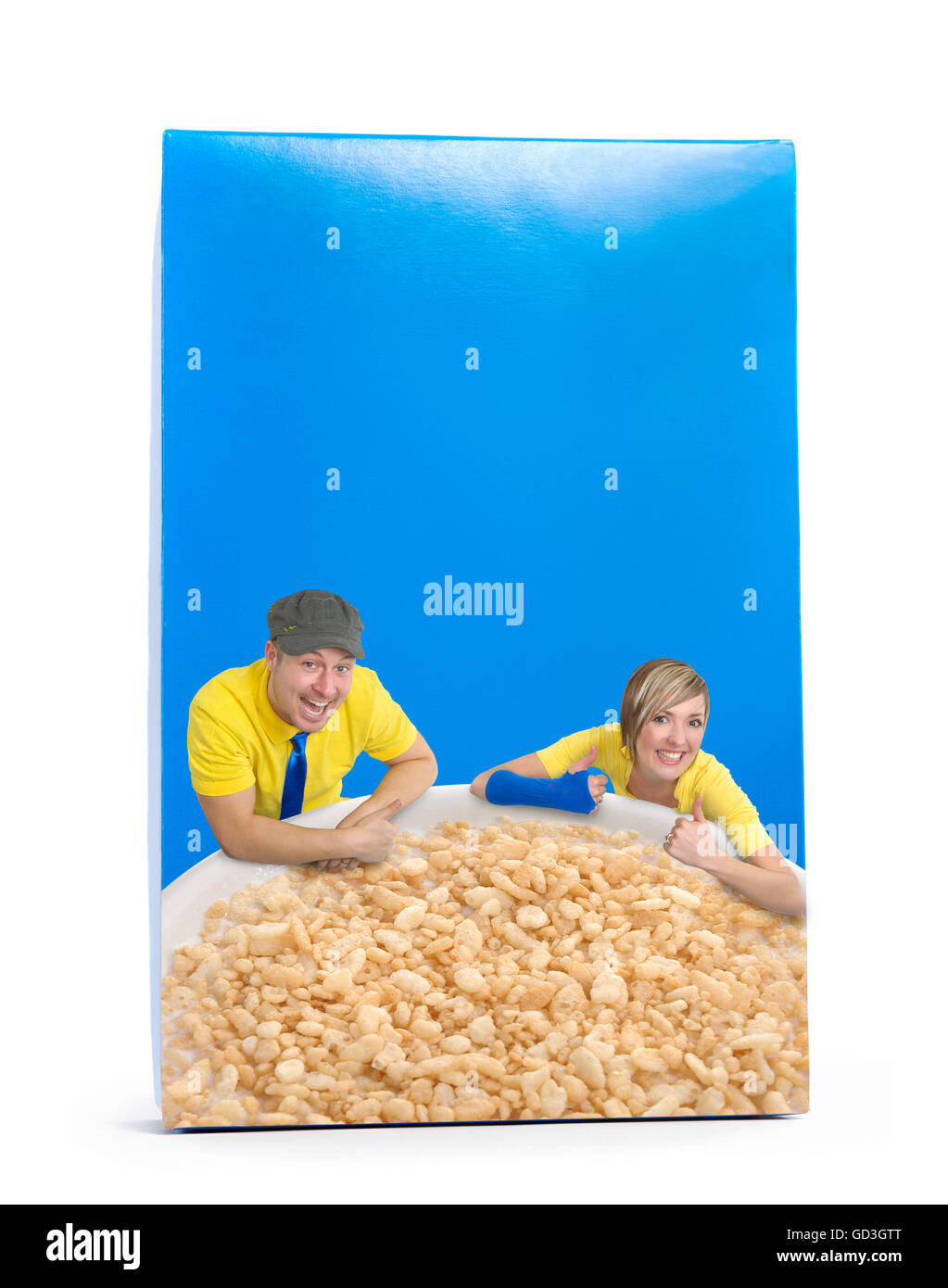 Young man and woman propping on a bowl of cereal, label of a blue box Stock Photo