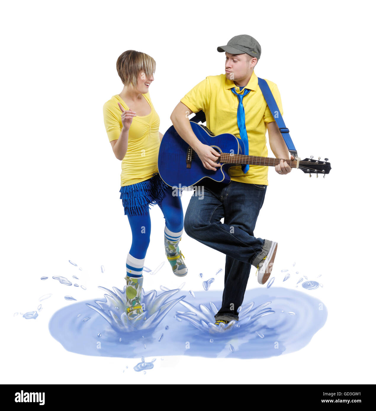Man with a guitar and woman dancing in a puddle with splashes of water around them - Stock Image