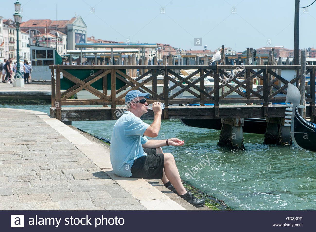 Venice, ITALY. 11 July, 2016. people try to cool off during the strong heat wave that hit Venice these days. Credit: - Stock Image