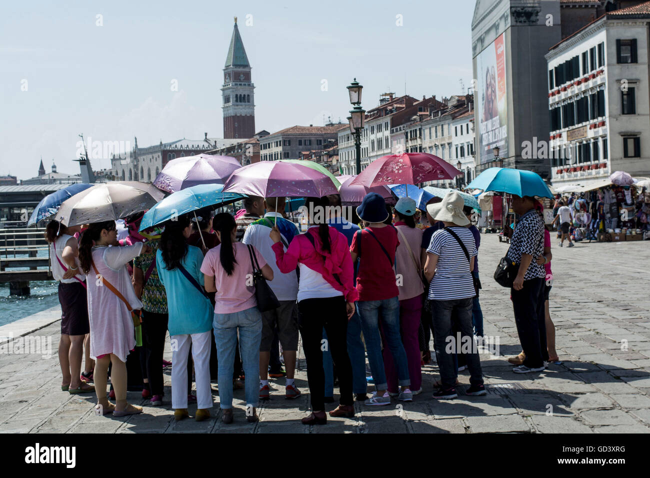 Venice, ITALY. 11 July, 2016. people try to cool off during the strong heat wave that hit Venice these days Credit: - Stock Image