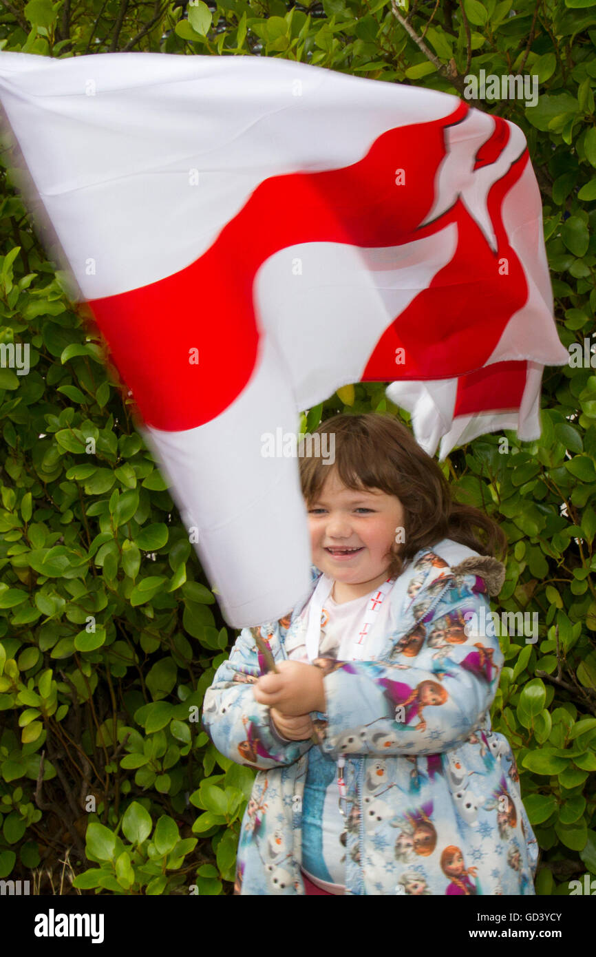 Southport, Merseyside, UK  12th July, 2016.  Annie McQuaide , 6 years old, at Southport Orangemen's day march through - Stock Image