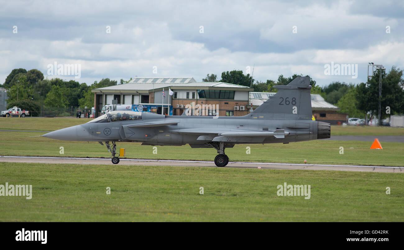 Farnborough, Hampshire UK. 12th July 2016. Saab JAS 39 Gripen prepares for takeoff. Day 2 of the Farnborough International - Stock Image