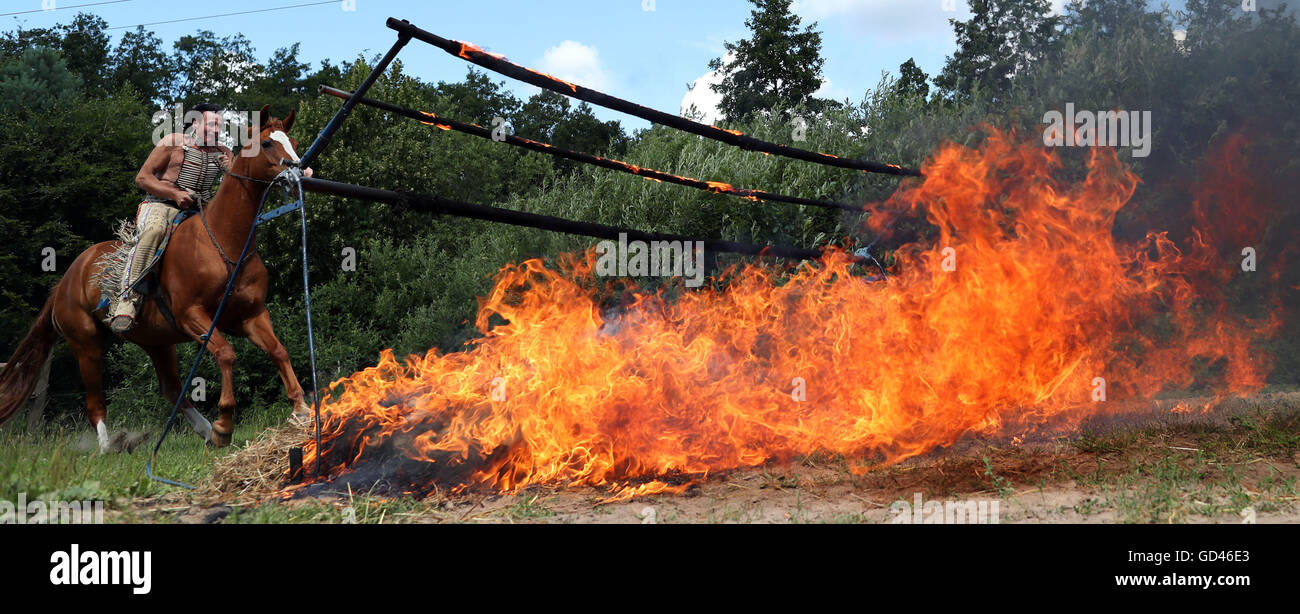 65-year-old vocational Native American and stuntman Wolfgang Kring jumps across a burning fire wall during a training - Stock Image