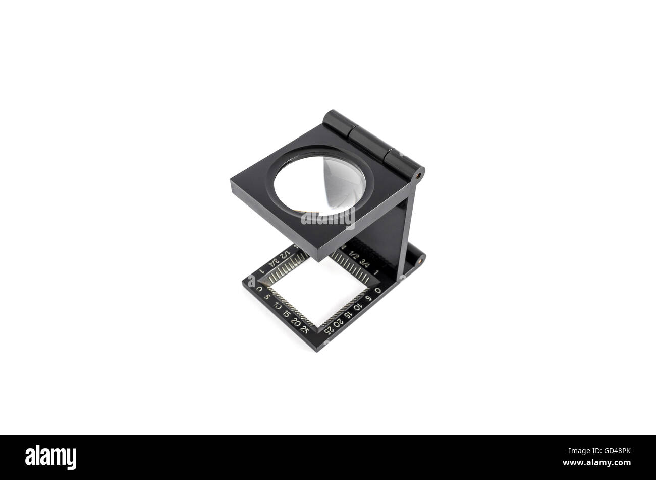 The magnifying glass standing usage for test printing. isolated on white background. - Stock Image