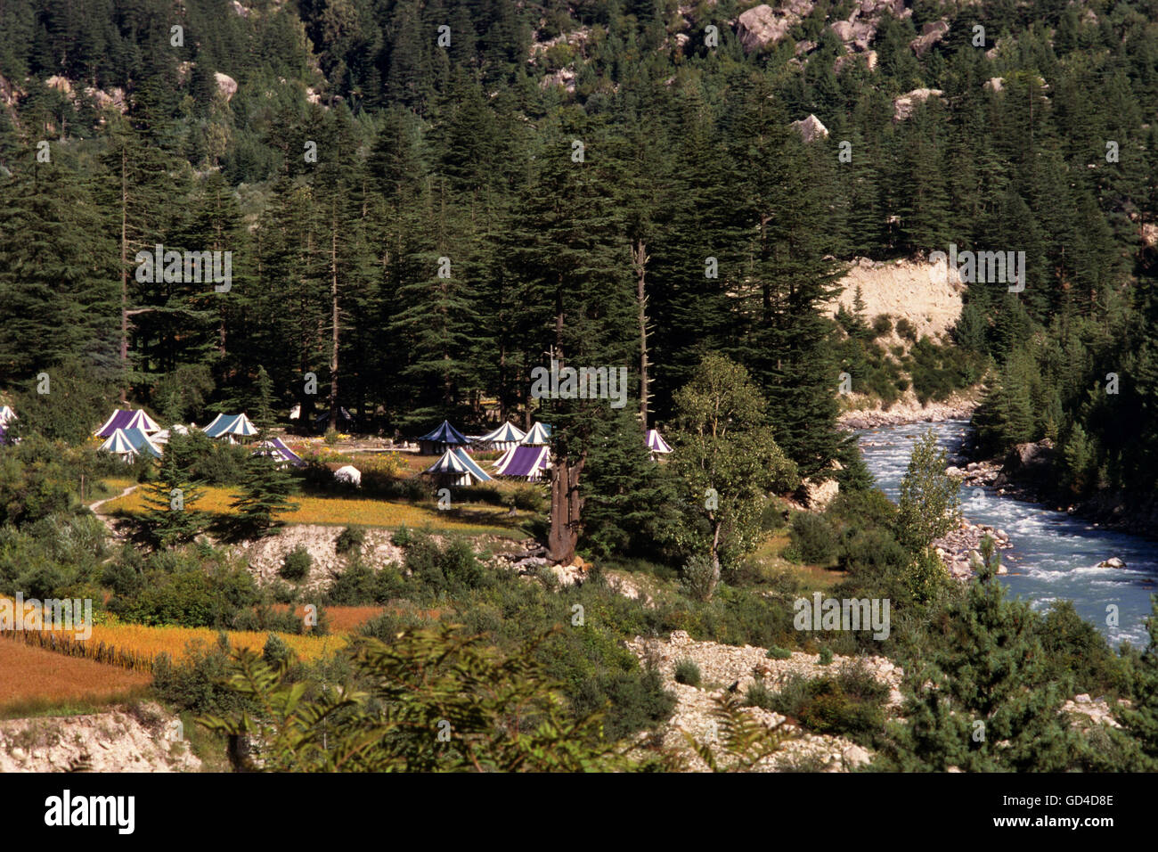 Banjara camps along the sparkling Baspa river - Stock Image