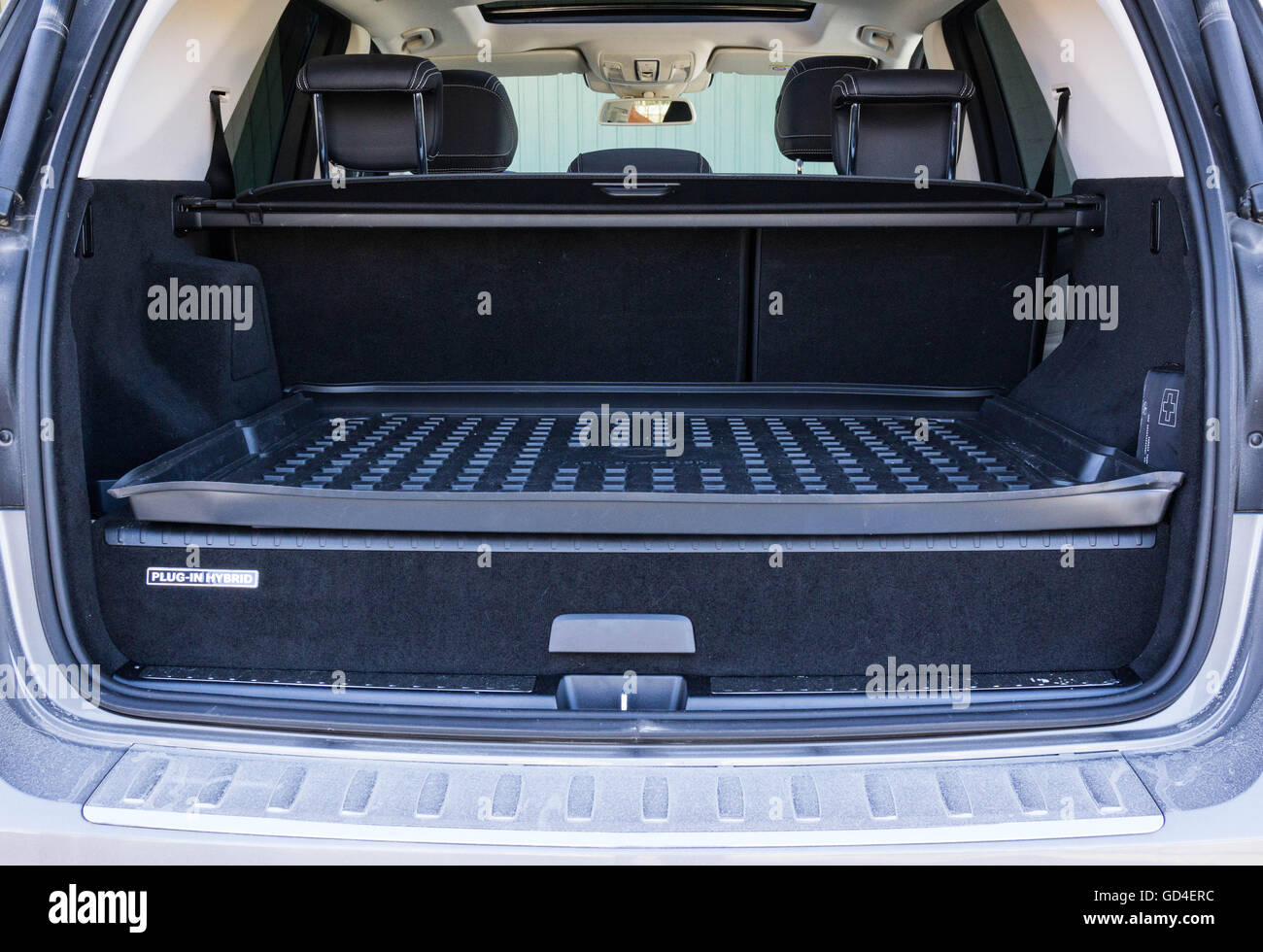 Hybrid suv, with open trunk showing battery package. Stock Photo