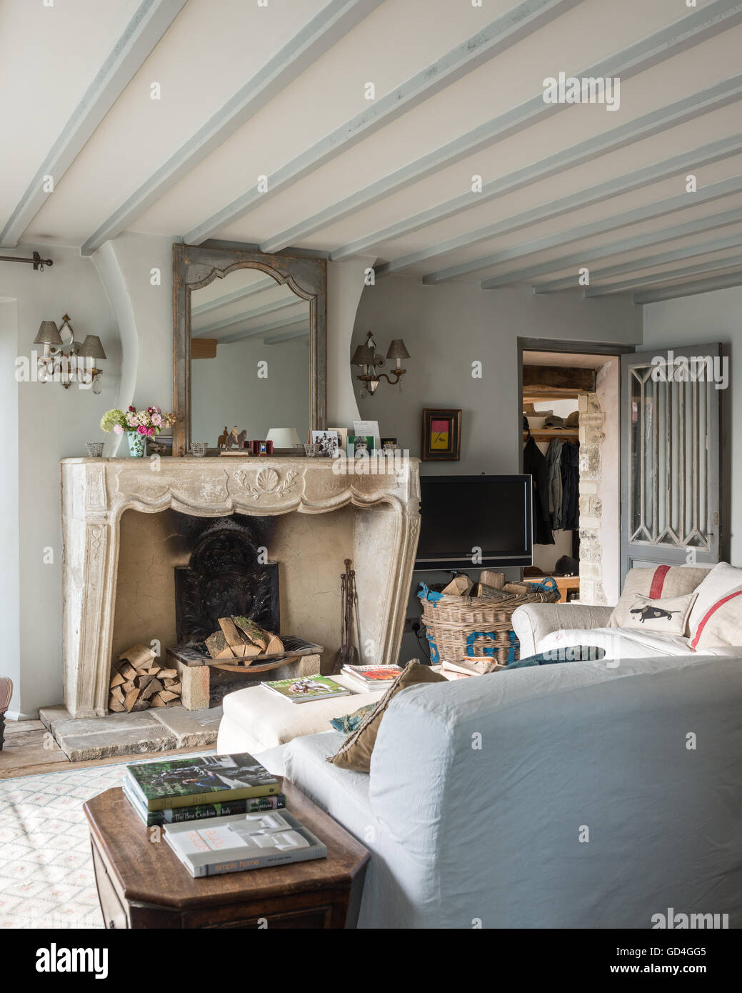 French fireplace with linen slip upholstery - Stock Image