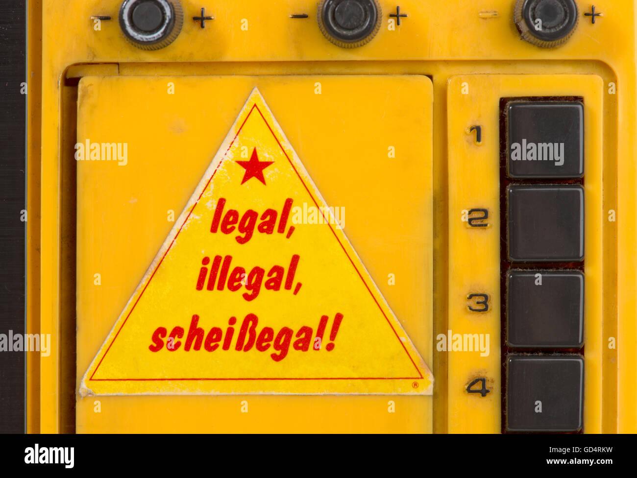 literature, aphorism, 'Legal, illegal, scheissegal!' (Legal, illegal, all bullshit), sticker on television - Stock Image
